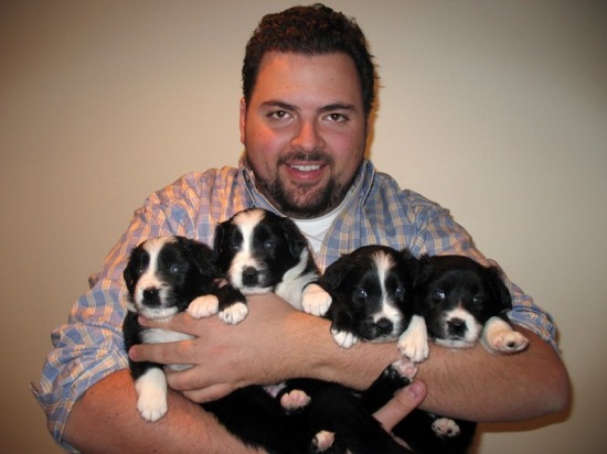 Christopher holding Zeke, Bella, Max, and Gemma.